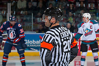 KELOWNA, CANADA - JANUARY 7: Referee Chris Crich stands at centre ice at the Kelowna Rockets against the Kamloops Blazers on January 7, 2017 at Prospera Place in Kelowna, British Columbia, Canada.  (Photo by Marissa Baecker/Shoot the Breeze)  *** Local Caption ***