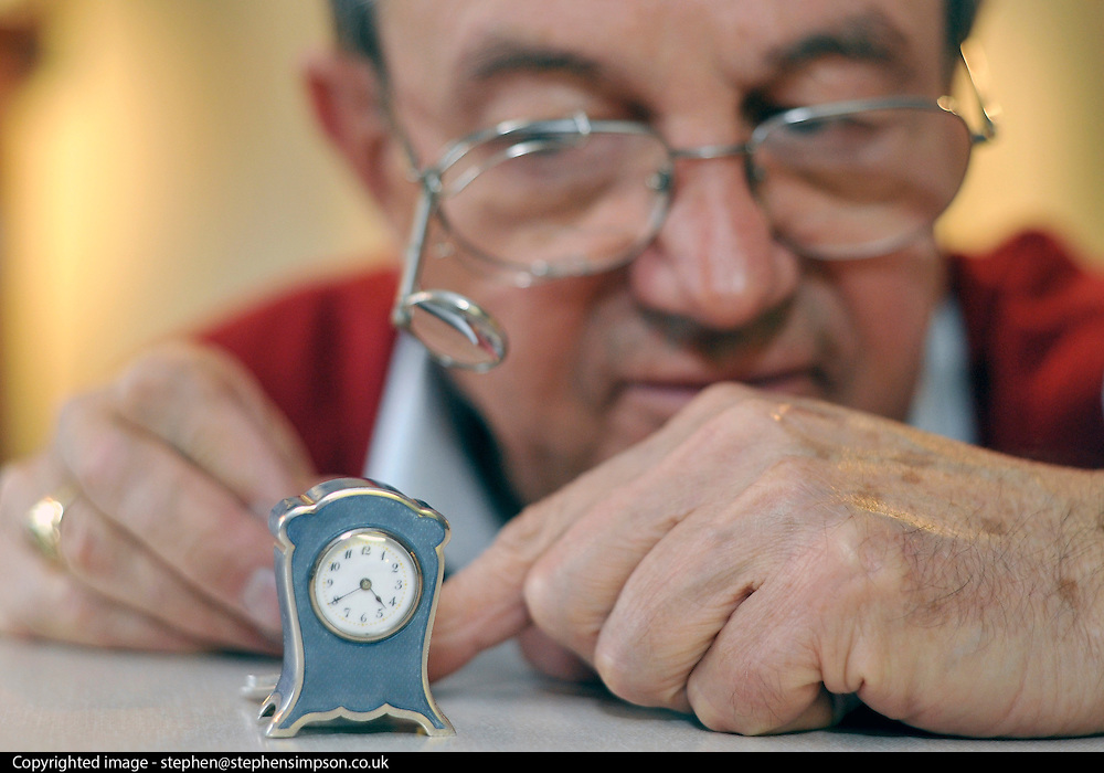 "©London News pictures...28/10/2010.  Michael Tooke changes the time on the smallest clock in the shop, a Swiss Guilloche Enamel from the early 1900's. . Staff at Horological Workshops start the task of changing the 100's of clocks at their store in Guildford, Surrey, UK. Micahel Tooke who has owned the store for 43 years and worked in the clock business all his life said. ""at this time of year we get alot of people who bring clocks in for repair after they have changed the time incorreectly by winding back the hands manually"""