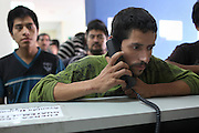 """Leopoldo Francisco Cifuentes Perez, 28, from Palo Grande Hamlet in Chiantla, Huehuetenango, speaks with his family through a complimentary phone service at the Migration Office in Guatemala City's La Aurora Airport after having been deported from the United States. Leopoldo, who can not read or write, states: """"This is the second time I try to reach my brother-in-law who is in Florida. The first time I was caught in 2010 in Phoenix, now I got caught in Houston. I have a wife and two kids and we do not have a home, so I will try again to go up North and earn some money to build my family a little house."""" Francisco claims he lost his down payment of 13,000 Quetzales (roughly $1,600 US) to his Coyote, or smuggler. He was supposed to pay the remaining 25,000 Quetzales of the 38,000 Quetzales it costs to cross, but he was caught before reaching Houston. Guatemala City, Guatemala. May 17, 2013."""
