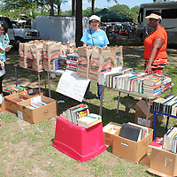 (Floyd Ingram / Buy at photos.chickasawjournal.com)<br /> The Houston Carnegie Library sold books at the 35th Annual Flywheel Festival and was one of many local organizations with a booth at the event.