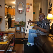 Mr. Johnson waits for Reggie Griffin to fix dinner in the kitchen. John E. Johnson, who is not eligible for medicaid, receives services for 12 hours per week through Illinois' Community Care Program. Johnson worries his services will be cut if the state transition seniors like him to a new program. The state employs Reggie Griffin to help Johnson with daily chores so he is able to stay in his home, as opposed to going to an nursing home. <br /> Photography by Jose More