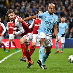 Vincent Kompany of Manchester City battles for the ball with Shkodran Mustafi of Arsenal