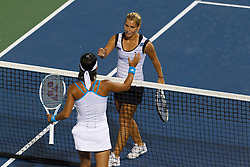 July 25, 2011; Stanford, CA, USA;  Dominika Cibulkova (SVK), top, shakes hands with Kimiko Date-Krumm (JPN) after the first round of the Bank of the West Classic women's tennis tournament at the Taube Family Tennis Stadium. Cibulkova defeated Date-Krumm 6-2, 7-6.