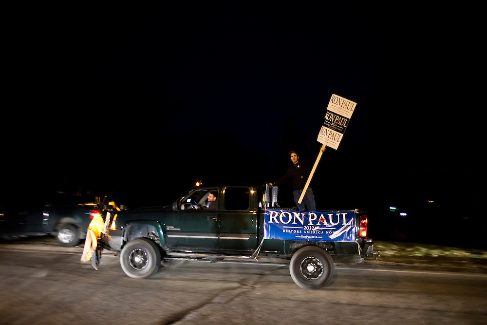 Supporters of Republican presidential candidate Ron Paul rally outside the site of the WMUR/ABC News Debate at Saint Anselm College on Saturday, January 7, 2012 in Manchester, NH. Brendan Hoffman for the New York Times