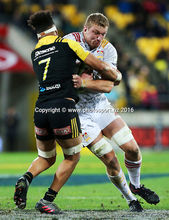 Chiefs' Dominic Bird is tackled by Hurricanes' Ardie Savea during the Investec Super Rugby Semi-Final match, Hurricanes v Chiefs at Westpac Stadium, Wellington, New Zealand. 30th July 2016. © Copyright Photo: Grant Down / www.photosport.nz