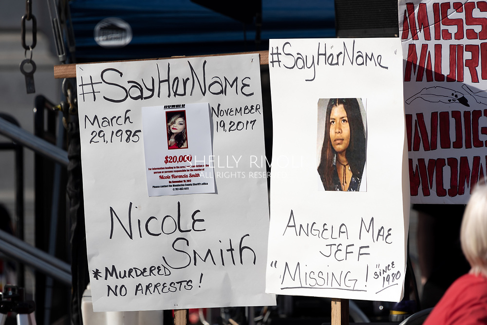 San Francisco, USA. 19th January, 2019. The Women's March San Francisco begins with a rally at Civic Center Plaza in front of City Hall. Missing and murdered indigenous women was a prominent theme at the march and rally, as shown in these signs sharing information about two affected Native American women, one murdered and one missing, with the hashtag #sayhername. Credit: Shelly Rivoli/Alamy Live News