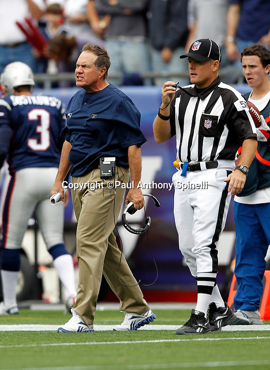 New England Patriots Head Coach Bill Belichick yells toward the field during the NFL regular season week 3 football game against the Buffalo Bills on September 26, 2010 in Foxborough, Massachusetts. The Patriots won the game 38-30. (©Paul Anthony Spinelli)
