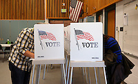 A man and woman vote their ballots in the U.S. midterm elections at a polling place in Westminster, Colorado November 4, 2014.    REUTERS/Rick Wilking (UNITED STATES)