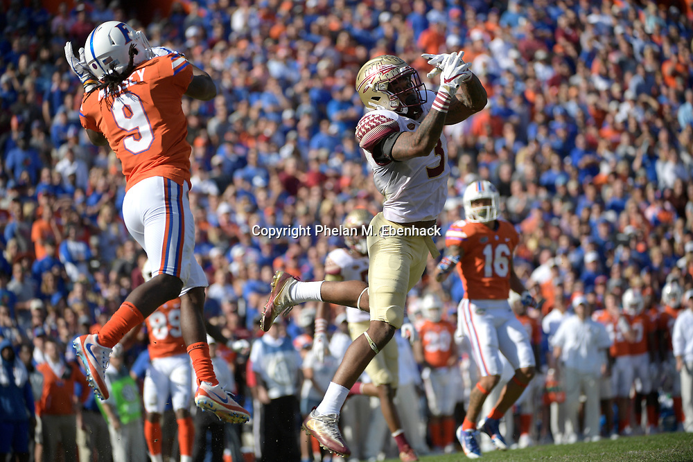 Florida State defensive back Derwin James (3) deflects a pass intended for Florida wide receiver Dre Massey (9) during the first half of an NCAA college football game Saturday, Nov. 25, 2017, in Gainesville, Fla. (Photo by Phelan M. Ebenhack)