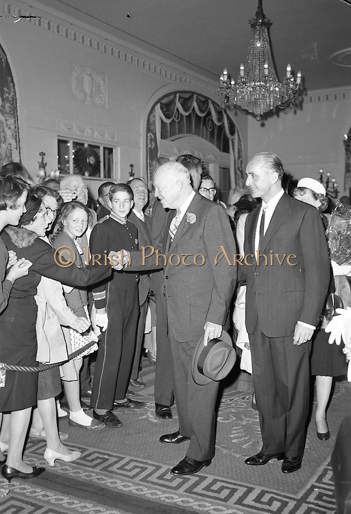 Handshakes for General Dwight D. Eisenhower as he arrives at the Gresham Hotel in the company of the Managing Director, Mr. T. O'Sullivan..21.08.1962