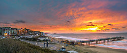 © London News Pictures. 01/01/2016. Boscombe, UK.Sunrise on New Years day overlooking Boscombe Pier in Boscombe, Dorset January 1, 2016. Photo credit: Carl Draper/LNP
