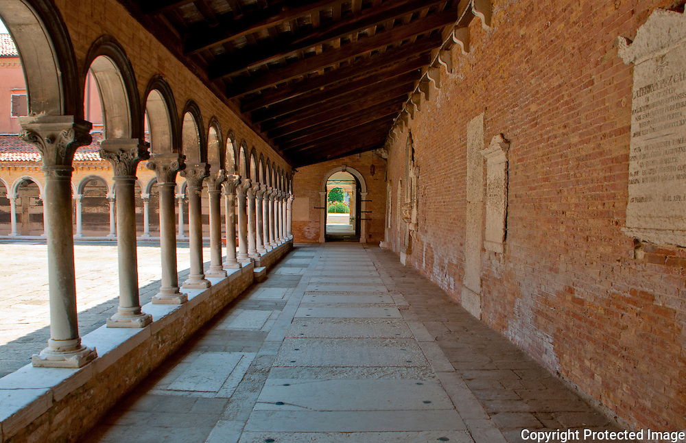The ancient inner courtyard of a mausoleum on Isola San Michel in Venice, Italy.