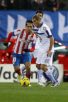 09.12.2012 SPAIN -  La Liga 12/13 Matchday 15th  match played between Atletico de Madrid vs R.C. Deportivo de la Courna (6-0) at Vicente Calderon stadium. The picture show Arda Turan (Turkish midfielder of At. Madrid)