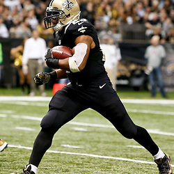 Dec 29, 2013; New Orleans, LA, USA; New Orleans Saints running back Pierre Thomas (23) against the Tampa Bay Buccaneers during the third quarter of a game at the Mercedes-Benz Superdome. Mandatory Credit: Derick E. Hingle-USA TODAY Sports