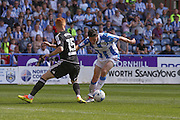 Huddersfield Town midfielder Joe Lolley (18)  goes through during the EFL Sky Bet Championship match between Huddersfield Town and Brentford at the John Smiths Stadium, Huddersfield, England on 6 August 2016. Photo by Simon Davies.