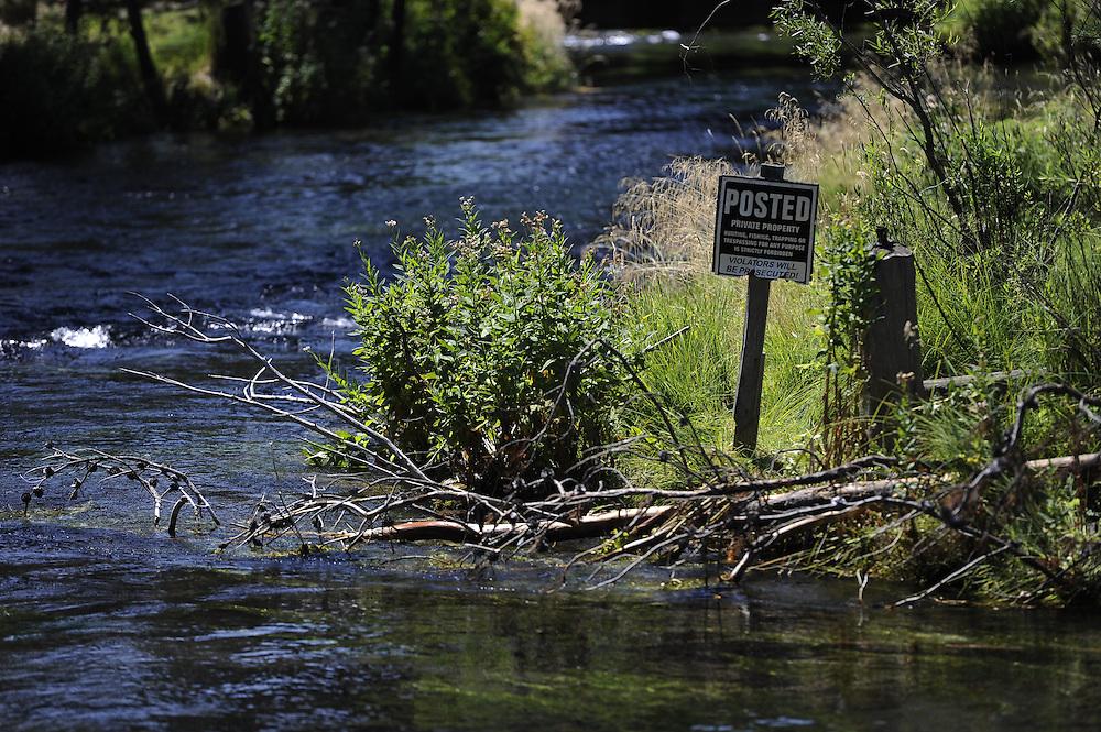 No trespassing sign along a river.