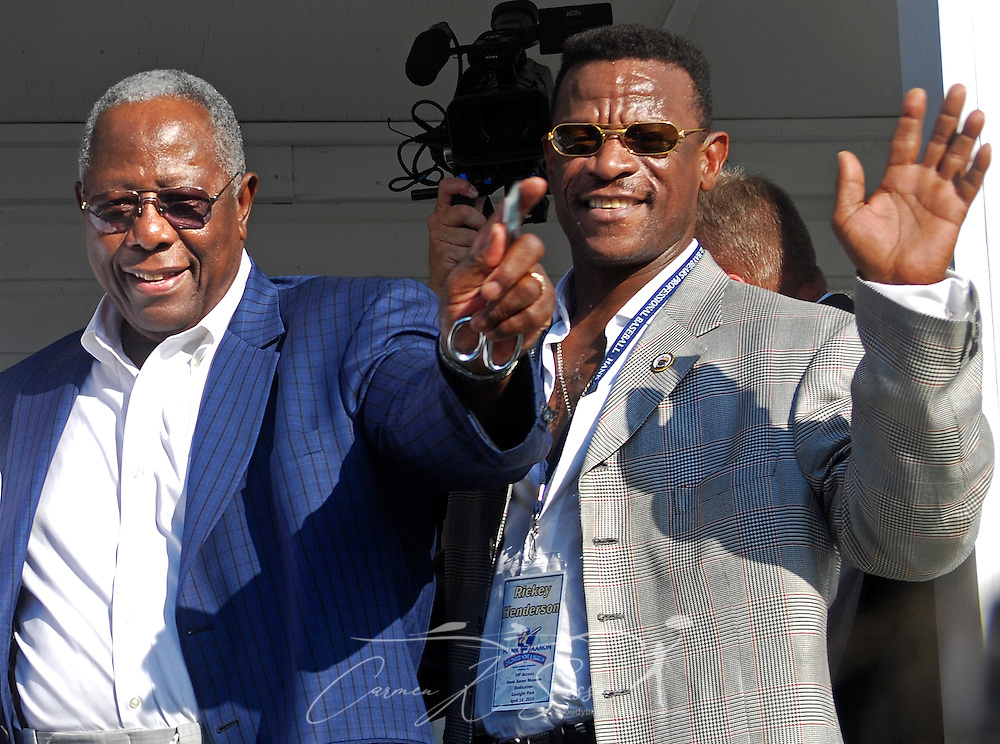 Hank Aaron and Rickey Henderson waved to fans during the dedication of the Hank Aaron Childhood Home & Museum on Thursday, April 15, 2010 at Hank Aaron Stadium in Mobile, Ala. Aaron's childhood home was relocated from the Toulminville neighborhood to the stadium. (Apex MediaWire Photo by Carmen K. Sisson)