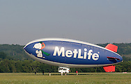 Montgomery, NY - Members of the ground crew watch as the MetLife blimp Snoopy Two takes off from Orange County Airport in Montgomery on July 26, 2008.