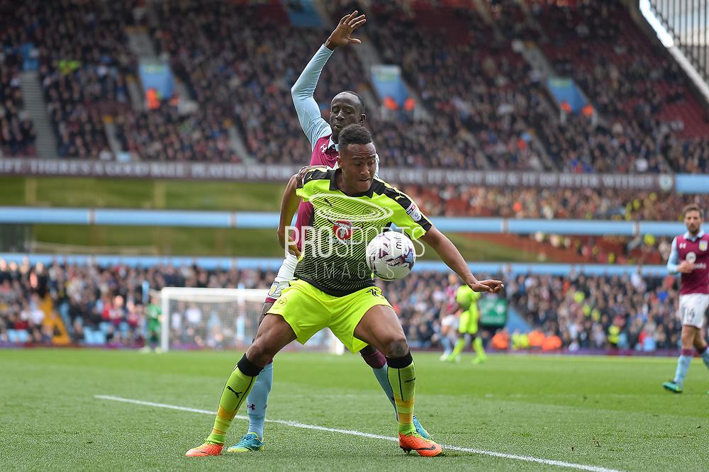 Reading defender Jordan Obita (11) holds up the ball during the EFL Sky Bet Championship match between Aston Villa and Reading at Villa Park, Birmingham, England on 15 April 2017. Photo by Dennis Goodwin.