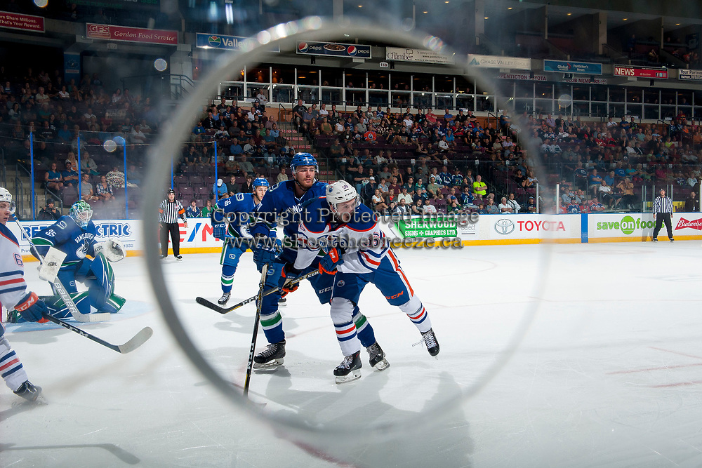 PENTICTON, CANADA - SEPTEMBER 11: Kailer Yamamoto #56 of Edmonton Oilers checks a player of the Vancouver Canucks on September 11, 2017 at the South Okanagan Event Centre in Penticton, British Columbia, Canada.  (Photo by Marissa Baecker/Shoot the Breeze)  *** Local Caption ***