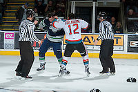 KELOWNA, CANADA -FEBRUARY 10: Tyrell Goulbourne #12 of the Kelowna Rockets drops the gloves with Jared Hauf #33 of the Seattle Thunderbirds in the final moments of the third period withon February 10, 2014 at Prospera Place in Kelowna, British Columbia, Canada.   (Photo by Marissa Baecker/Getty Images)  *** Local Caption *** Tyrell Goulbourne; Jared Hauf;