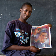 George Obama, the half brother of US presidential hopeful Barack Obama, holds a photo of his brother at a school near Mathare where he lives.