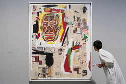 "© Licensed to London News Pictures. 20/09/2017. London, UK. A woman views ""King of the Zulus"", 1984-85, by Jean-Michel Basquiat. Preview of ""Basquiat: Boom for Real"", the first large-scale exhibition in the UK of the work of American artist Jean-Michel Basquiat (1960-1988) taking place at the Barbican Art Gallery, 21 September-28 January 2018. Photo credit : Stephen Chung/LNP"