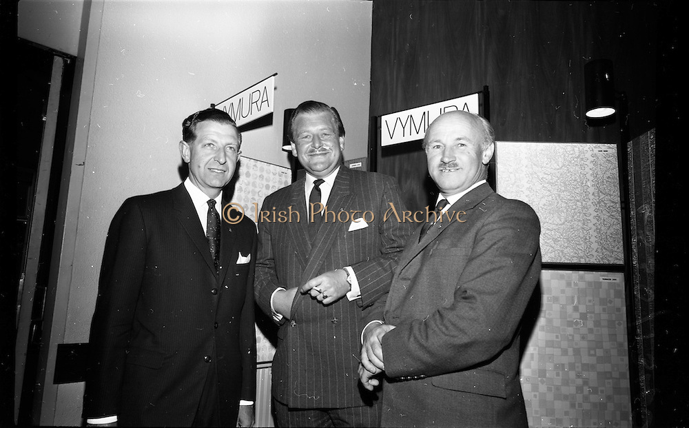 "23/06/1965<br /> 06/23/1965<br /> 23 June 1965<br /> I.C.I. (Imperial Chemical Industries) ""Vymura""  luxury wall covering (wallpaper?) demonstration at the Intercontinental Hotel, Dublin. Pictured at the event were (l-r) Mr. D.W. Moore, (Paints Division) I.C.I.; Mr. T.P. casey, Commercial Director, I.C.I. (Ireland) `Ltd. and Mr. J.K.D. Lacey, Sales Manager, I.C.I. (Ireland) Ltd."