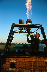 GERMANY SCHLESWIG-HOLSTEIN KIEL 9JUN02 - Balloon pilot Andreas Kuhel tests the burners on his balloon's basket before commencing flight preparations...jre/Photo by Jiri Rezac..© Jiri Rezac 2002..Contact: +44 (0) 7050 110 417..Mobile:  +44 (0) 7801 337 683.Office:  +44 (0) 20 8968 9635..Email:   jiri@jirirezac.com.Web:     www.jirirezac.com