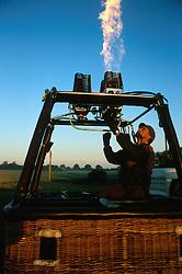 GERMANY SCHLESWIG-HOLSTEIN KIEL 9JUN02 - Balloon pilot Andreas Kuhel tests the burners on his balloon's basket before commencing flight preparations...jre/Photo by Jiri Rezac..© Jiri Rezac 2002..Contact: +44 (0) 7050 110 417..Mobile:  +44 (0) 7801 337 683.Office:  +44 (0) 20 8968 9635..Email:   jiri@jirirezac.com.Web:     www.jirirezac.com
