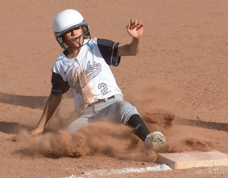 gbs040617u/SPORTS -- Volcano Vista's Alyssa Dilley, 2, steals third base in the fifth inning during the game at Cibola on Thursday, April 6, 2017. (Greg Sorber/Albuquerque Journal)
