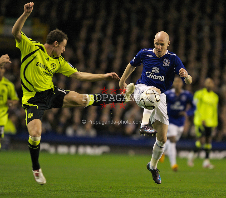 LIVERPOOL, ENGLAND - Wednesday, January 23, 2008: Everton's Andy Johnson and Chelsea's Wayne Bridge during the League Cup Quarter-Final 2nd Leg match at Goodison Park. (Photo by David Rawcliffe/Propaganda)