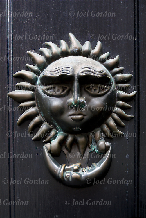 Decorative and functional sun and moon door knocker.