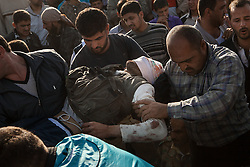 Friends and relatives carrying the dead body of Abo Khattab Alsifrini, 20, a member of the FSA  killed in a checkpoint by the result of an ambush made by mercenaries and security forces which left 9 fatalities include one civilian in the outskirts of Babis, north Aleppo. Anadan, north Syria, saturday, April 21, 2012...Saturday morning eight members of the FSA and one civilian were killed by the result of an ambush made by mercenaries and security forces close to a checkpoin in the outskirts of Babis, north Aleppo. ...*In this town, 10 persons have been found dead,15 wounded and one missing in an attack were 18 tanks, 14 military cars and arround 300 soldiers burned down 118 houses and 120 shops in a operation by the Syrian regime of Bashar-Al-Assad at April 13th and 14th activist says, Syria, April 21, 2012. Photo by Daniel Leal-Olivas / i-Images...