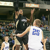 Lancer forward Aaeron Smith (4) takes a jump shot over Pioneer forward Drew Moore (25)
