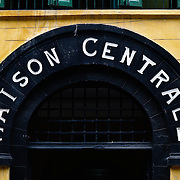 The original French colonial sign over the main entrance to Hoa Lo Prison museum. Hoa Lo Prison, also known sarcastically as the Hanoi Hilton during the Vietnam War, was originally a French colonial prison for political prisoners and then a North Vietnamese prison for prisoners of war. It is especially famous for being the jail used for American pilots shot down during the Vietnam War.