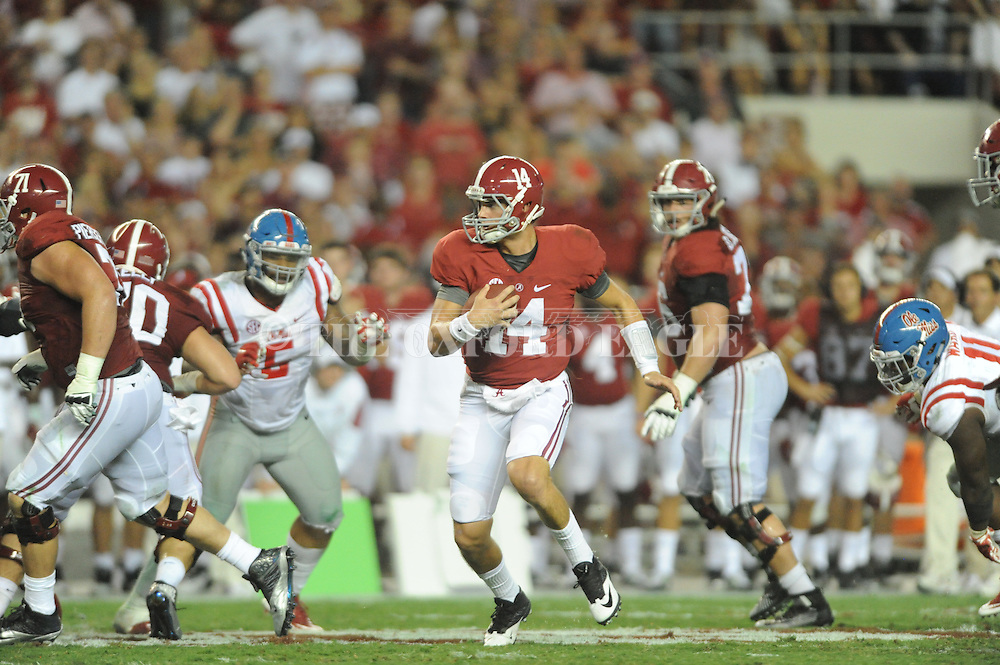 Ole Miss vs. Alabama Crimson Tide quarterback Jake Coker (14) at Bryant-Denny Stadium in Tuscaloosa, Ala. on Saturday, September 19, 2015. Ole Miss won 43-37.