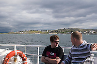 passengers on ferry leaving the Aran Islands in Galway Ireland