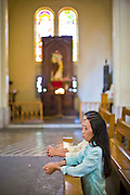 09 MARCH 2006 - HO CHI MINH CITY, VIETNAM: Vietnamese Catholic women pray in Notre Dame Cathedral in Ho Chi Minh City, (formerly Saigon) Vietnam. The Vietnamese government has loosened some of the restrictions on religion and Catholicism is growing again in Vietnam. Photo by Jack Kurtz