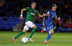 Jason Cummings of Peterborough United in action with Leo Ostigard of Brighton & Hove Albion - Mandatory by-line: Joe Dent/JMP - 09/10/2018 - FOOTBALL - ABAX Stadium - Peterborough, England - Peterborough United v Brighton and Hove Albion U21 - Checkatrade Trophy