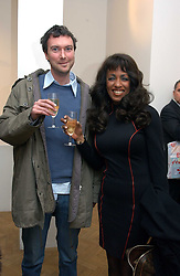 Singer SHEILA FERGUSON and MR ALEX SAINSBURY son of the Hon.Sir Tim Sainsbury at an exhibition of work by Daniel Chadwick held at Beaux Art, Cork Street, London on 1st February 2005.<br />