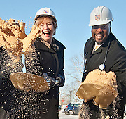 BREAKING GROUND--Sub freezing tempteratures didn't put the skids on Howard Community College president Kate Hetherington and Howard County Council chairperson Calvin Ball from having fun in a sandbox breaking ground for the new Health Sciences building at the college.