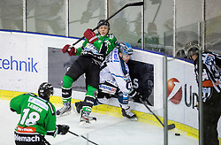25.01.2015, Hala Tivoli, Ljubljana, SLO, EBEL, HDD Telemach Olimpija Ljubljana vs EHC Liwest Linz, 43. Runde, in picture Sebastijan Hadzic (HDD Telemach Olimpija, #30) and Curtis Murphy (EHC Liwest Linz, #41) during the Erste Bank Icehockey League 43. Round between HDD Telemach Olimpija Ljubljana and EHC Liwest Linz at the Hala Tivoli, Ljubljana, Slovenia on 2015/01/25. Photo by Vid Ponikvar / Sportida