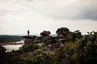 A man overlooks the vast landscape of Bokor, in the mountains of southern Cambodia.