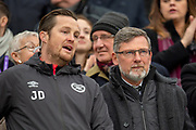 Craig Levein, manager of Heart of Midlothian speaks with coach Jon Daly (left) in the stand before the 4th round of the William Hill Scottish Cup match between Heart of Midlothian and Livingston at Tynecastle Stadium, Edinburgh, Scotland on 20 January 2019.