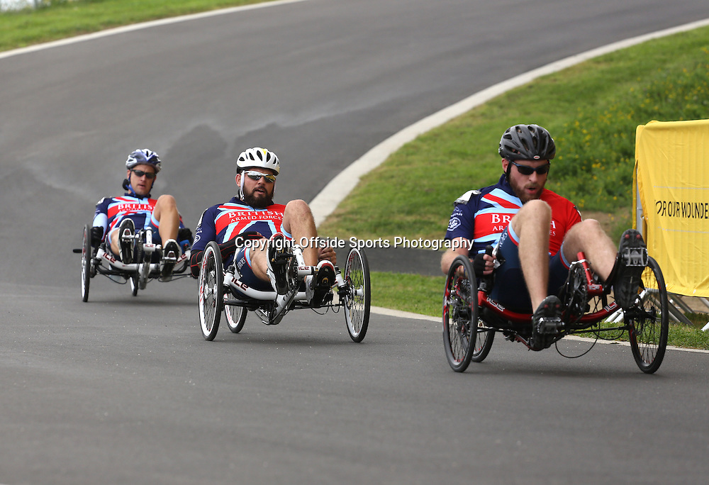 13 September 2014 - Invictus Games Day 3 - Three Team GB riders come round the downhill bend of the Road Race.<br /> <br /> Photo: Ryan Smyth/Offside
