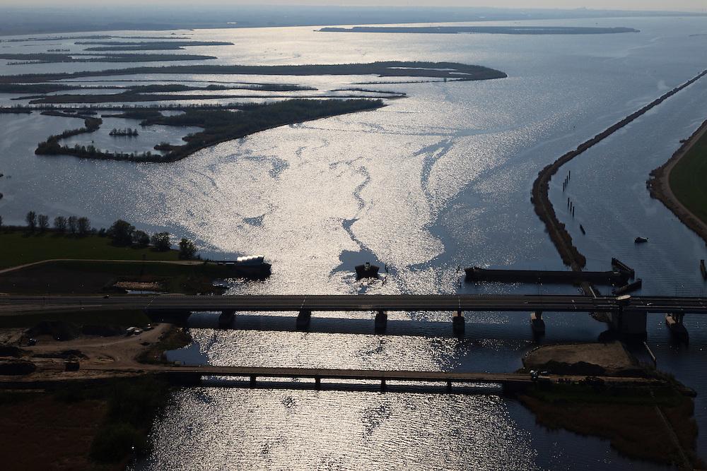 Nederland, Flevoland-Overijssel, Ramspol, 01-05-2013; nieuwe Ramspolbrug in de N50 met achter de brug de balgstuw. Rechts de vaargeul het Ramsdiep, links van de strekdam het Ketelmeer.<br /> <br /> Ramspol, inflatable dike, between Ketelmeer and Black Water. The Balgstuw (bellow barrier) is a storm barrier and consists of an inflatable dam or dyke, composed of three bellows. Usually, each bellow rests on the bottom of the water, but now the bellows are inflated  because of maintenance. luchtfoto (toeslag op standard tarieven)<br /> aerial photo (additional fee required)<br /> copyright foto/photo Siebe Swart
