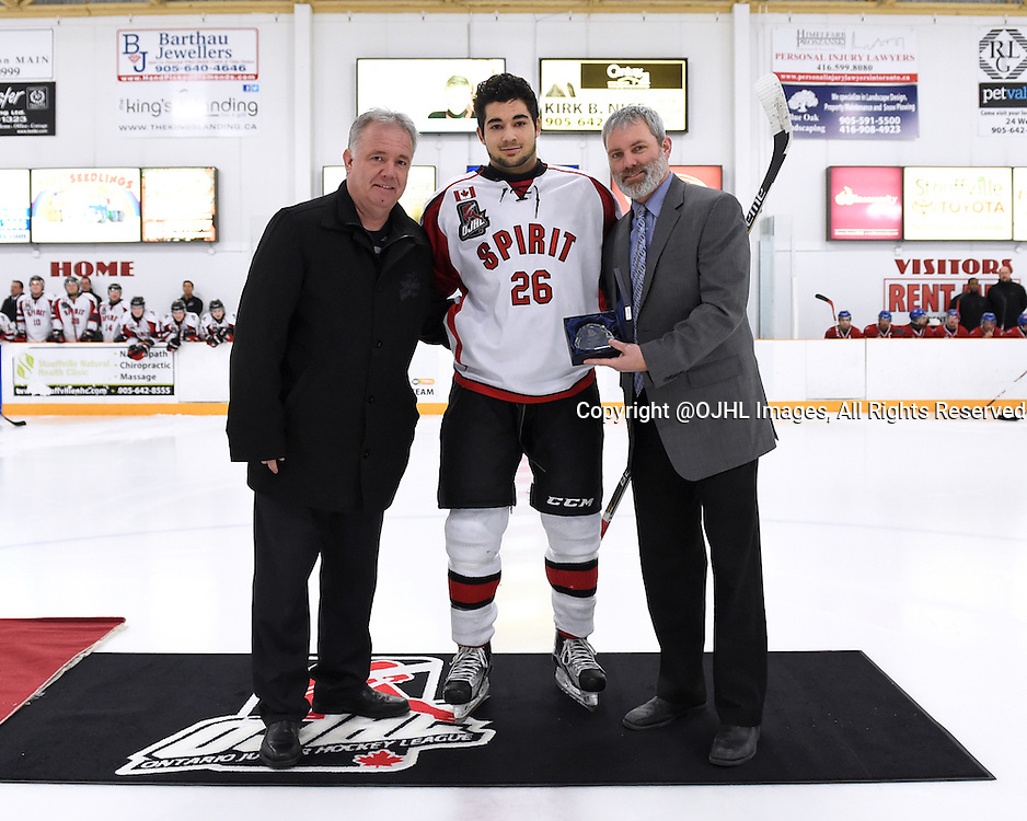 STOUFFVILLE, - Jan 30, 2016 -  Ontario Junior Hockey League game action between Kingston and Stouffville at the Stouffville Arena, ON. Ryan Dasilva #26 of the Stouffville Spirit receives player of the month award for December from OJHL Director of Operations Izak Westgate and Stouffville Spirit Governor Ken Burrows.<br /> (Photo by Andy Corneau / OJHL Images)