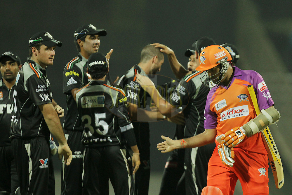 VVS Laxman of Kochi Tuskers Kerala walks back dejected as Pune Warriors celebrates during  match 10 of the Indian Premier League ( IPL ) Season 4 between the Pune Warriors and the Kochi Tuskers Kerala held at the Dr DY Patil Sports Academy, Mumbai India on the 13th April 2011..Photo by BCCI/SPORTZPICS