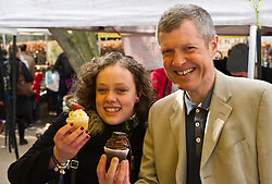 Pictured:  Hannah Bettsworth, Liberal Democrat candidate for Edinburgh Central and the Lothian regional list, and Wiillie Rennie enjoying the display at the Vanilla Cream stall<br /> <br /> Liberal Democrat leader Willie Rennie and  Hannah Bettsworth, Liberal Democrat candidate for Edinburgh Central and the Lothian regional list, headed to Stockbridge today to meet Easter shoppers and stallholders at the Sunday farmers market. <br /> <br /> Ger Harley | EEm 27 March 2016